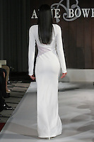 Model walks runway in a Hudson wedding dress by Anne Bowen, for the Anne Bowen Bridal Spring 2012 runway show.