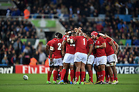 The Tonga team huddle together before the start of the second half. Rugby World Cup Pool C match between New Zealand and Tonga on October 9, 2015 at St James' Park in Newcastle, England. Photo by: Patrick Khachfe / Onside Images