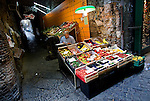 A street vendor sells fresh produce in the Spaccanapoli shopping district of Naples.