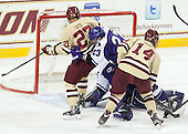 Quinn Smith (BC - 27), Ryan McGrath (HC - 23), Adam Gilmour (BC - 14) - The visiting College of the Holy Cross Crusaders defeated the Boston College Eagles 5-4 on Friday, November 29, 2013, at Kelley Rink in Conte Forum in Chestnut Hill, Massachusetts.