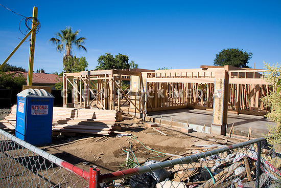 Large two story wooden single family house under for Home building sites