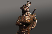 Chief of the Multnomah Tribe, bronze sculpture, 1905, by Hermon Atkins MacNeil, 1866-1947, from the collection of the Denver Art Museum, Denver, Colorado, USA. The chief wears a feather headdress and has shield, bow and arrows on his back. Picture by Manuel Cohen