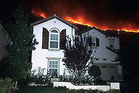 870000328 the topanga wildfire rages uncontrolled on a ridge line above homes in the agoura hills in los angeles county california