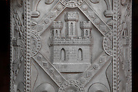 Detail of a low relief depicting a Castilian castle, trumeau of the lower chapel  of La Sainte-Chapelle (The Holy Chapel), 1248, Paris, France. The Castilian castle symbolizes Blanche de Castille, mother of Saint Louis. La Sainte-Chapelle was commissioned by King Louis IX of France (Saint Louis) to house his collection of Passion Relics, including the Crown of Thorns. It is considered among the highest achievements of the Rayonnant period of Gothic architecture. Picture by Manuel Cohen