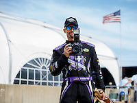 Jul 10, 2016; Joliet, IL, USA; NHRA funny car driver Jack Beckman holds a camera as celebrate after winning the Route 66 Nationals at Route 66 Raceway. Mandatory Credit: Mark J. Rebilas-USA TODAY Sports