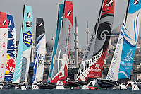 Extreme Sailing Series 2011. Act 3.Turkey . Istanbul..Pictures of the fleet sailing close to the shoreline as they start racing.