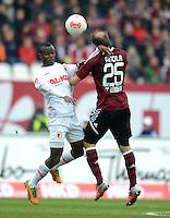 FUSSBALL   1. BUNDESLIGA  SAISON 2012/2013   8. Spieltag 1. FC Nuernberg - FC Augsburg       21.10.2012 Knowledge Musona (li, FC Augsburg) gegen Javier Pinola  (1 FC Nuernberg)
