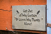 &quot;Get out of My Garden . . . &quot; whimsical sign in Amy Stewart's garden
