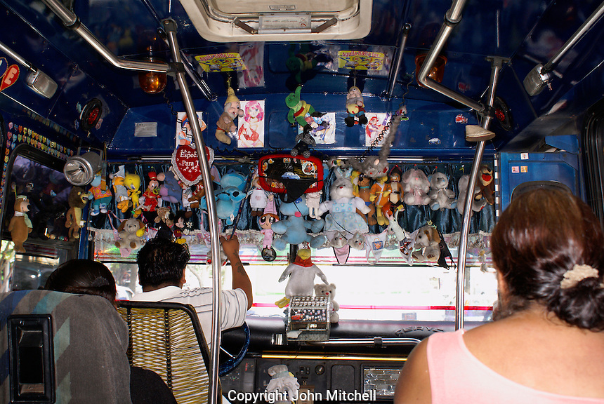 Stuffed animals hanging from a public bus in Acapulco, Mexico.