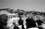 barwaiz raghzia hills, south waziristan, april 2004: deep in the south eastern mountains of south waziristan, a tribal lashkar gathers in preparation for a hunt of suspected al qaeda fighters and supporters.<br />