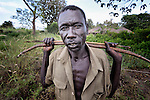 Raphael Juma hunts for small game with a bow and arrows in the Southern Sudan village of Pisak. The weapon is also used for self-defense against soldiers from the Lord's Resistance Army, which occasionally operates in the area.