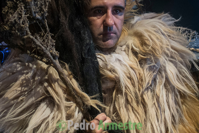 """A man dressed for Carantoña before mass during the Carantoñas festival, in Acehúche near Cáceres, on January 21, 2015. The """"Carantoñas"""", monster-animal characters mixing paganism with Christianity, search for Saint Sebastian in the streets of the village of Acehúche, southwestern Estremadure province, dressed in patchwork sheep, cow, rabbit and goatskins under painted masks. Arriving eventually at the village church, a procession takes place with the statue of the patron saint. Until recently, Spain's neighbors, the Berbers of Morocco, preserved a version of the same ritual in their animal-hided winter """"goblin,"""" Bou Inania.  © Pedro ARMESTRE"""