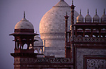 The view of the dome of the Taj Mahal as seen beyond the East Gate entrance. Taken from a nearby building roof.