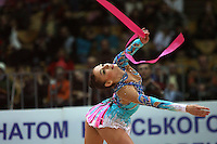 """Evgenia Kanaeva of Russia performs with ribbon at 2008 World Cup Kiev, """"Deriugina Cup"""" in Kiev, Ukraine on March 22, 2008. .Photo note: Closeup view version."""