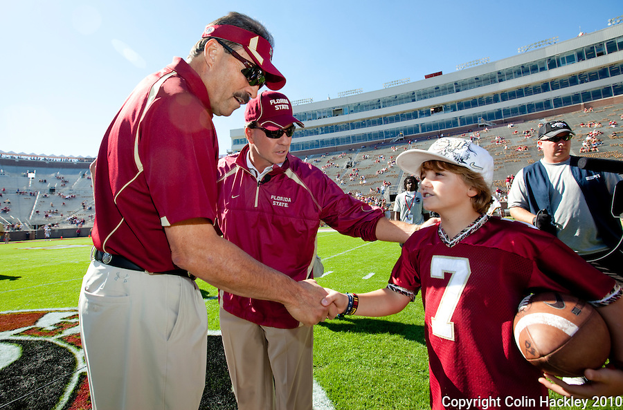 TALLAHASSEE, FL 10-FSU-BC 101610 FB10 CH-Florida State's Head Coach Jimbo Fisher, center, introduces his son Trey, right to Boston College Head Coach Frank Spaziani prior to the game Saturday at Doak Campbell Stadium in Tallahassee. .COLIN HACKLEY PHOTO