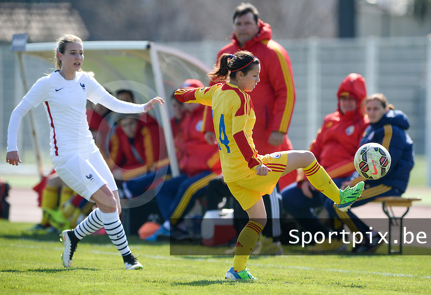 20150406 - OZOIR , FRANCE  : Romanian Mihaele Merlan (right)  pictured controllin the ball in front of French Heloise Mansuy (left)  during the soccer match between Women Under 19 teams of France and Romania , on the second matchday in group 3 of the UEFA Elite Round Women Under 19 at Stade des 3 Sapins , Ozoir La Ferriere , France . Monday 6th April 2015 . PHOTO DAVID CATRY
