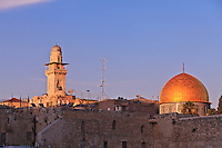 The Dome of the Rock and a nearby minaret are visible from the area of the Western Wall in Jerusalem.