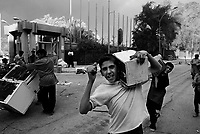 Baghdad, Iraq, April 10, 2003.People looting the Al Mansour Hotel. On the morning after the entry of US Army in Baghdad, thousands of baghdadis from the poorer quarters of the city started to loot all official buildings houses of important people of Saddam's regime.