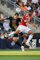 Alejandro Moreno (15) of the Philadelphia Union and Rodolfo Espinoza (24) of CD Chivas USA go up for a header during a Major League Soccer (MLS) match at PPL Park in Chester, PA, on September 25, 2010.