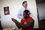 FRESNO, CA - AUGUST 11, 2014:   Fresno State's athletic director Thomas Boeh jokes with a mildly injured Jaamal Rose after morning football practice. CREDIT: Max Whittaker for The New York Times