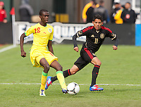 San Francisco, California - Saturday March 17, 2012: Souleymane Cisse and Javier Aquino in action during the Mexico vs Senegal U23 in final Olympic qualifying tuneup. Mexico defeated Senegal 2-1