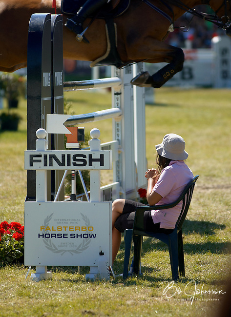 Athena rests during the wait for the horse to reach the finish line of the JMS Falsterbo Grand Prix. <br /> July 2006 at Falsterbo Horse Show, Vellinge, Sweden. <br /> Horse trials have since the 1920s proud traditions on the Falsterbo peninsula in southwestern Sweden, nowadays run as the international meeting Falsterbo Horse Show.<br /> In 2007 685 horses from 15 countries competed during the seven days of the meeting. <br /> July 2006.<br /> Only for editorial use.