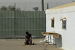 A Muslim detainee prays in a special detention facility within Ketziot Prison compound, designated for African asylum-seekers who have illegally crossed the nearby Egyptian-Israeli border.