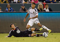 DC United midfielder Santino Quaranta attempts a tackle on LA Galaxy defender Sean Franklin. The LA Galaxy defeated DC United 2-1at Home Depot Center stadium in Carson, California on Saturday September 18, 2010.