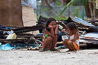 Sisters eating some food which has became sparse after typhoon Yolanda passed by their home and destroyed it
