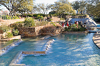 Wedding celebration at the pool and waterfalls in Hemisfair Park in San Antonio, Texas, USA.