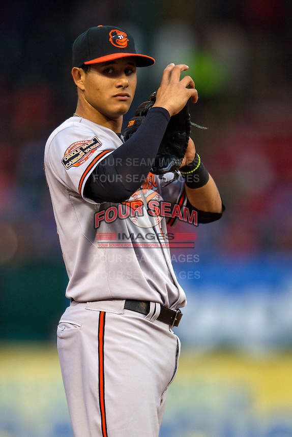 Baltimore Orioles third baseman Manny Machado #13 during the Major League Baseball game against the Texas Rangers on August 21st, 2012 at the Rangers Ballpark in Arlington, Texas. The Orioles defeated the Rangers 5-3. (Andrew Woolley/Four Seam Images).