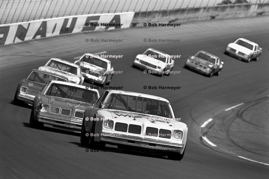 DAYTONA BEACH, FL - FEBRUARY 14: Dale Earnhardt drives the Bud Moore Ford ahead of a group of cars during the Daytona 500 NASCAR Winston Cup race at the Daytona International Speedway in Daytona Beach, Florida, on February 14, 1982.