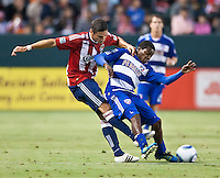 CARSON, CA – June 18, 2011: Chivas USA defender Zarek Valentin (20) and FC Dallas forward Marvin Chavez (18) during the match between Chivas USA and FC Dallas at the Home Depot Center in Carson, California. Final score Chivas USA 1, FC Dallas 2.
