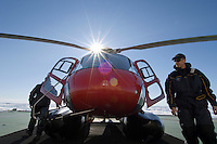Icebreaker helicopter that scouts for the best route through the ice pack and also transports scientists and equipment to conduct experiments on the ice, as well as being available for search and rescue, Arctic Ocean.