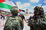 A Palestinian protester scuffles with Israeli soldiers during a demonstration in support of prisoners refusing food in Israeli jails at the Hawara checkpoint, south of Nablus in the Israeli-occupied West Bank, on May 23, 2017, during a visit of the US president to Israel and the Palestinian territories. A general strike in support of Palestinian hunger strikers in Israeli prisons, coincided with Trump's arrival in Israel and the Palestinian territories. Photo by Ayman Ameen