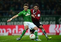 FUSSBALL   1. BUNDESLIGA   SAISON 2012/2013    20. SPIELTAG SV Werder Bremen - Hannover 96                           01.02.2013 Nils Petersen (re, SV Werder Bremen) gegen Karim Haggui (re, Hannover)