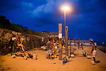 A rustic beach gym at Arproador still frequented by athletic types using barbells with concrete weights and chin-up bars, in Rio de Janeiro, Brazil, on Saturday, Feb. 2, 2013...