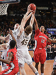 Pat Connaughton (24) Jack Cooley (45) and Rutgers Scarlet Knights guard Mike Poole (10) fight for a rebound in the first half.