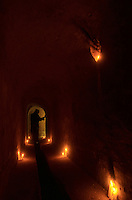 Monastery, monk in subterranean passage. subterranean, subterraneous, underground, subterranean cave, secret passage, mystery, religion, religious, candles, secret, passage, hidden, hidden passage, dark, darkness, obscure