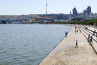 Azerbaijan, Baku. Baku Boulevard is a promenade that runs parallel to Baku's seafront. Baku TV Tower in the background, the tallest building in the country, 310 metres. Flame Towers, a residential complex under construction to the right.