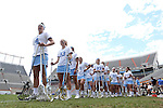 01 May 2016: North Carolina's Marie McCool (4) and her teammates line up to have their sticks checked before the game. The University of North Carolina Tar Heels played the Syracuse University Orange at Lane Stadium in Blacksburg, Virginia in the 2016 Atlantic Coast Conference Women's Lacrosse Tournament championship match. North Carolina won 15-14 in overtime.