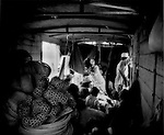 Mother shelters baby on train to Kampot, Cambodia.