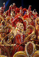Dancers from French cabaret Moulin Rouge perform atop an Academicos do Grande Rio samba school float down the Sambodrome on the first night of the Carnival samba school parade, Rio de Janeiro, Brazil, February 22, 2009.