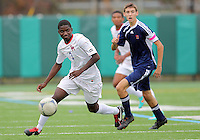 HYATTSVILLE, MD - OCTOBER 26, 2012:  William Kerr (3) of DeMatha Catholic High School moves the ball away from Jack Peden (17) of St. Albans during a match at Heurich Field in Hyattsville, MD. on October 26. DeMatha won 2-0.