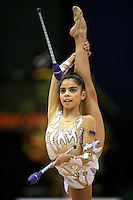 Filipa Siderova of Bulgaria...holds balance with leg behind with clubs at 2006 Aeon Cup Worldwide Clubs Championships in rhythmic gymnastics on November 16, 2006 at Mie, Japan.<br />