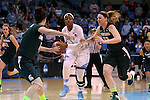 25 March 2014: North Carolina's Stephanie Mavunga (center) is defended by Michigan State's Becca Mills (52) and Tori Jankoska (left). The University of North Carolina Tar Heels played the Michigan State University Spartans in an NCAA Division I Women's Basketball Tournament First Round game at Cameron Indoor Stadium in Durham, North Carolina. UNC won the game 62-53.