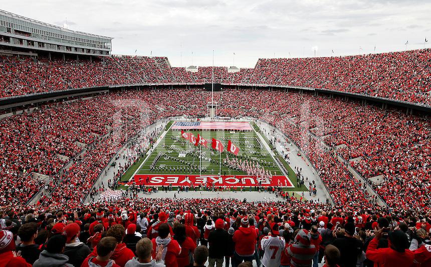 Ohio State's football team takes the field prior to the NCAA football game against Illinois at Ohio Stadium in Columbus, Ohio, on Nov. 3, 2012. (Adam Cairns / The Columbus Dispatch)