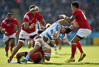 Pablo Matera of Argentina is tackled to ground. Rugby World Cup Pool C match between Argentina and Tonga on October 4, 2015 at Leicester City Stadium in Leicester, England. Photo by: Patrick Khachfe / Onside Images