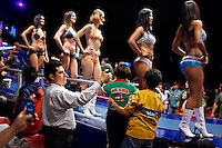 A man uses his camera to photograph models before the start of a Lucha Libre match. Lucha Libre is a style of wrestling started in Mexico in 1933. The name means Free Fight, and matches tend to be focussed on spectacle and theatre with fans cheering for their favourite characters, who wear masks while jumping from the ropes, flipping opponents, and occasionally crashing into the crowd..&copy;Jacob Silberberg/Panos/Felix Features.
