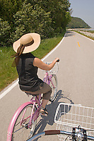 First person view of biking around Mackinac Island in Michigan with a woman in a sun hat.